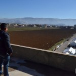 MERCY Malaysia Team Leader Pak Azam surveys the Al Abrar camp, near the border with Syria.